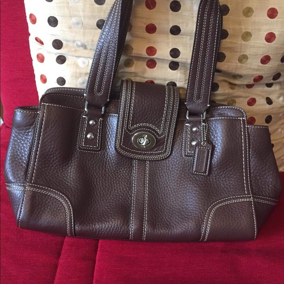 New Coach handbag in brown color.